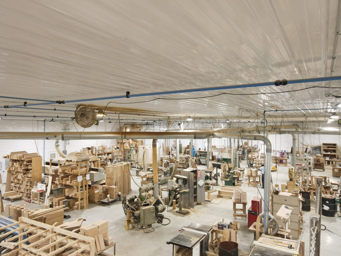 Inside of a large wood working shop.