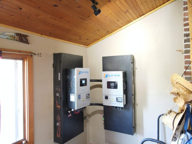 Gray solar installation breaker boxes on a wall.